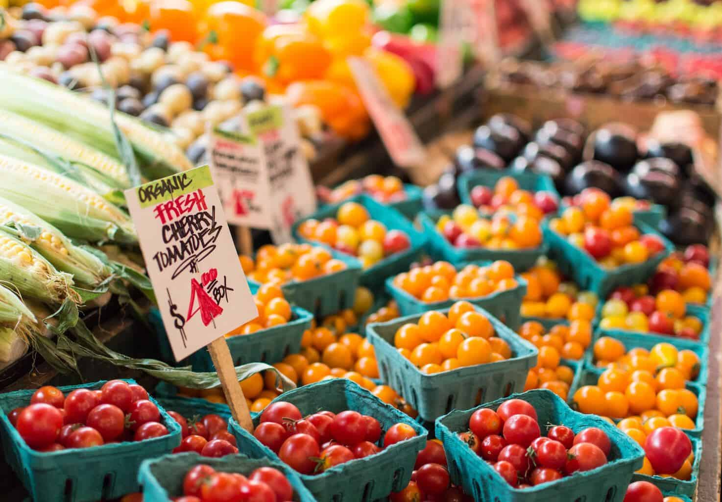 A colorful display of cherry tomatoes at a farmers market.