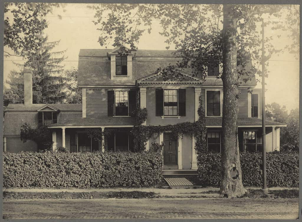 A black and white photo of a historic house in Jamaica Plain, Boston.