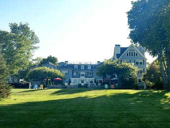 Bar Harbor, Maine's Balance Rock Inn seen with rolling green grass in front of it.