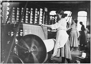 Historic black and white photo of two women working at Lowell Mill No. 5 and Lowell mill girls