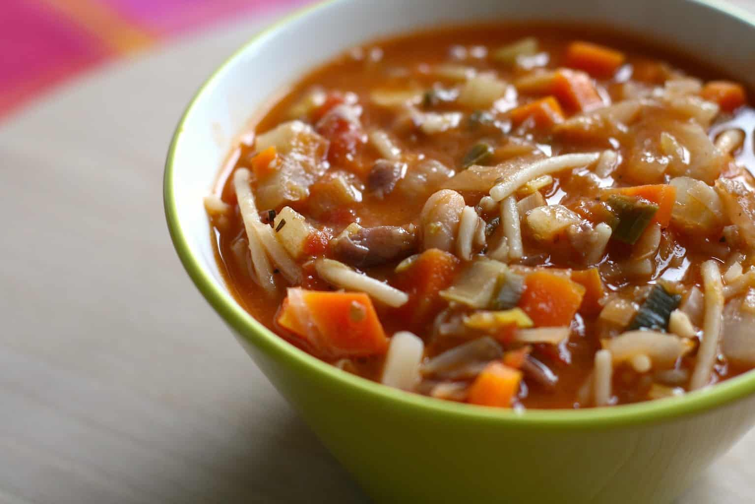 A close up of minestrone soup.