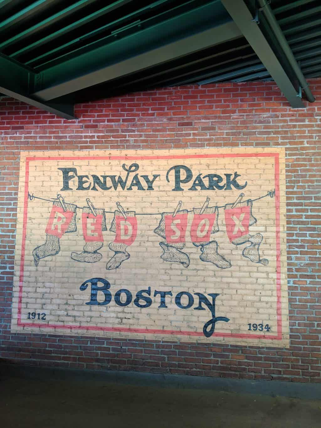 A historic mural on a brick wall inside Fenway Park, Boston.