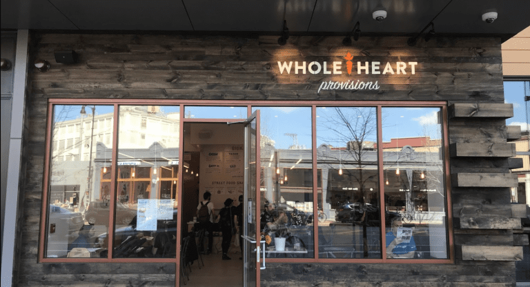 The exterior of Whole Heart Provisions as seen in Central Square.