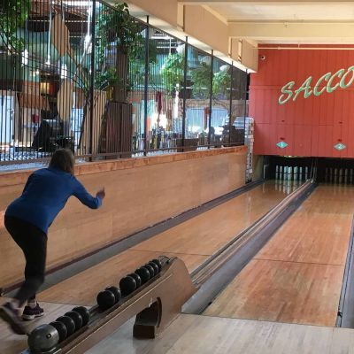A person throws a bowling ball at Saccos in Davis Square, Somerville.