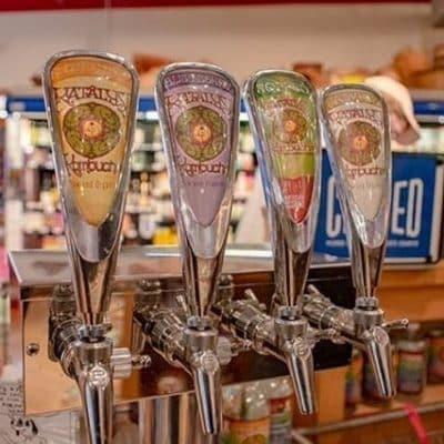 A close up of four bar taps as seen onOff the Beaten Path Food Tours' Jamaica Plain Food Tour.