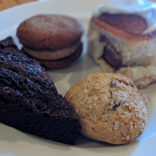 A grouping of pastries sits on a white plateon Off the Beaten Path Food Tours' Downtown Lowell Food Tour.