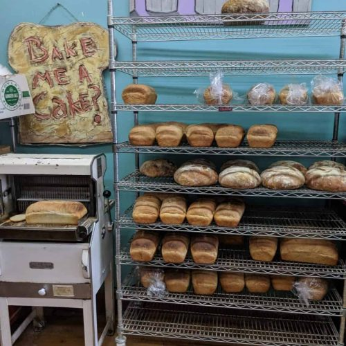 A rack of bread sits in a cafe as seen on Off the Beaten Path Food Tours' Roslindale Food Tour.