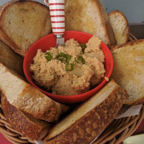 A basket of sliced bread and spread as seen on Off the Beaten Path Food Tours' Roslindale Food Tour.
