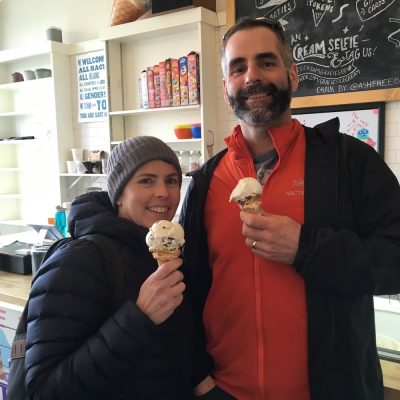 A couple smiles while eating ice cream on on Off the Beaten Path Food Tour's Union Square Food Tour.