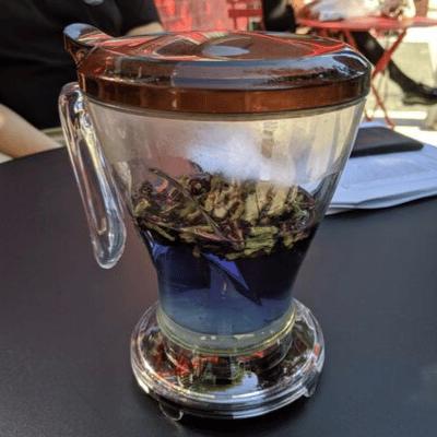 blue pea powder tea inside a tea maker