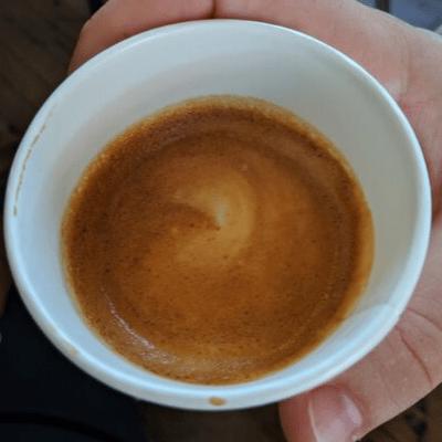 cortado espresso in a cup with latte art birds eye view