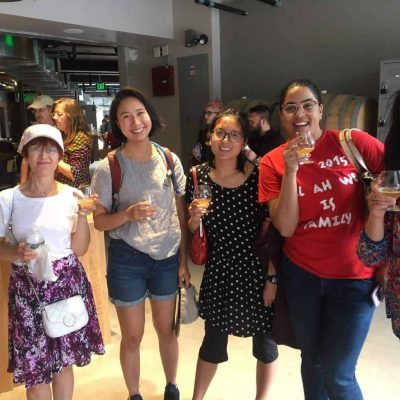 A group of four women smile while enjoying food on Off the Beaten Path Food Tour's Union Square Food Tour.